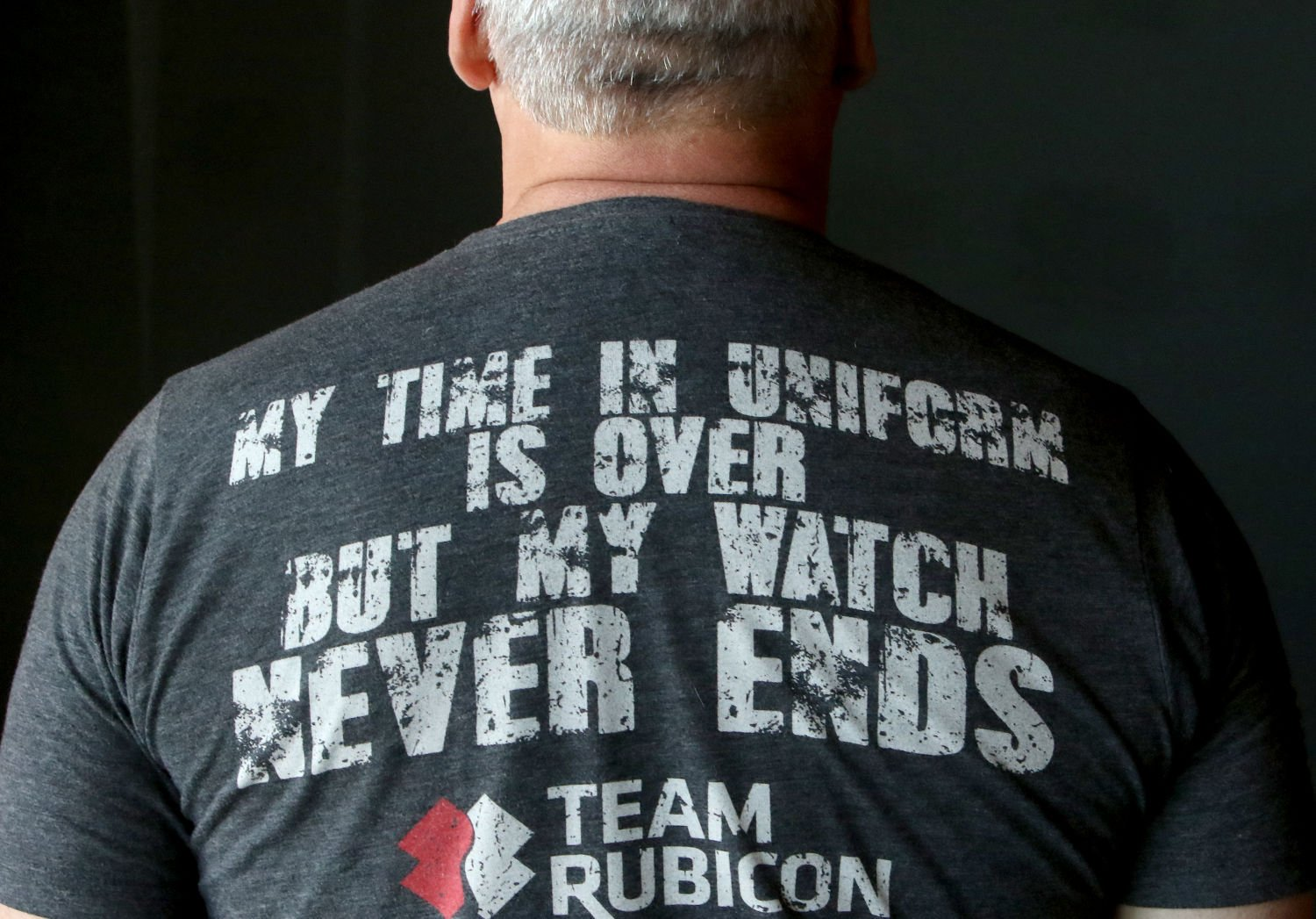 1879bc01b60a07 Veteran Sam Brokenshire wears a Team Rubicon t-shirt. He is a regional  field operations manager with Team Rubicon