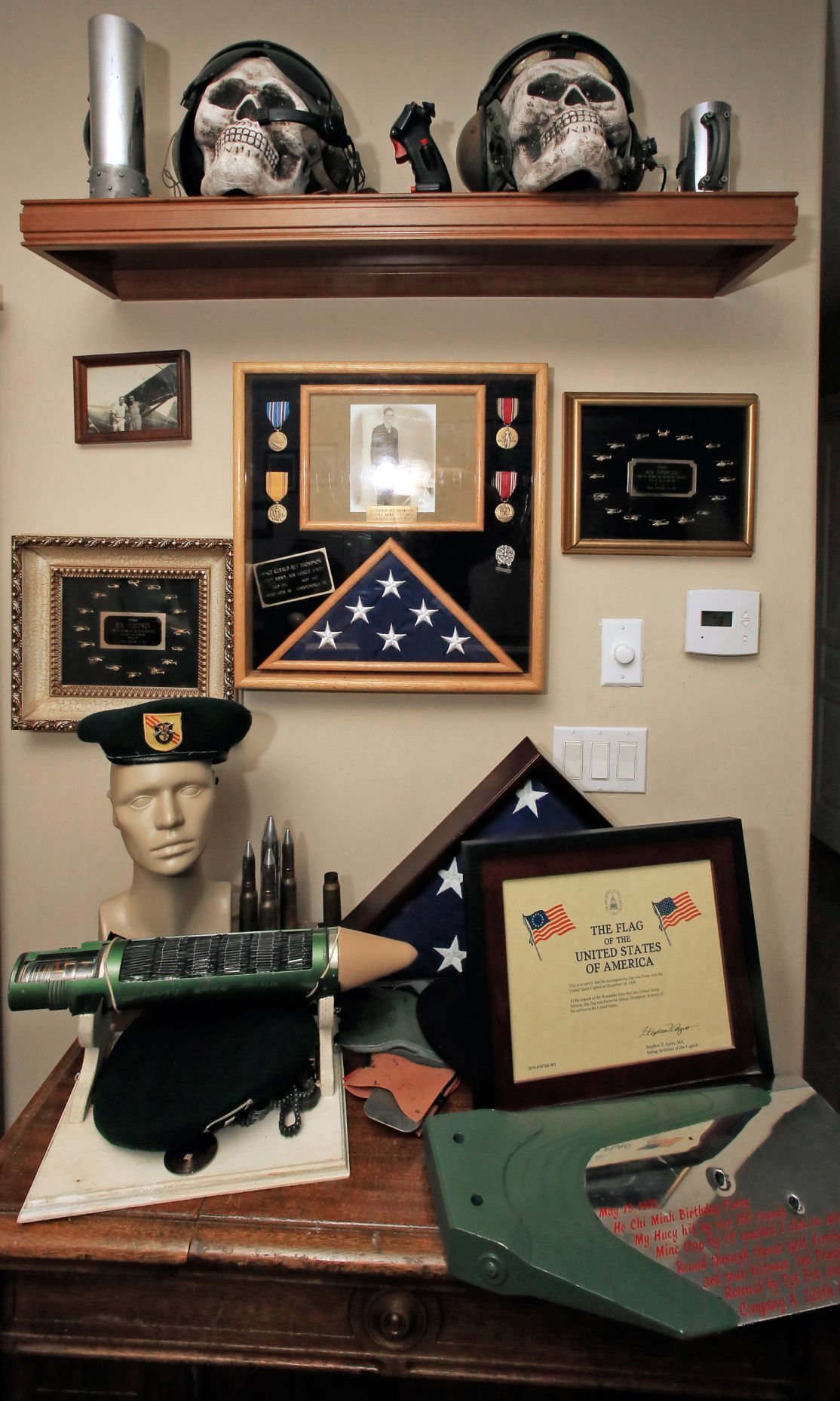 three time vietnam veteran johnny thompson keeps a collection of war momentos and his father s photo at his home in marana az thompson served three tours