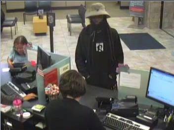 Man wears fake beard to rob OV bank
