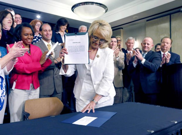 Brewer signs Medicare expansion law