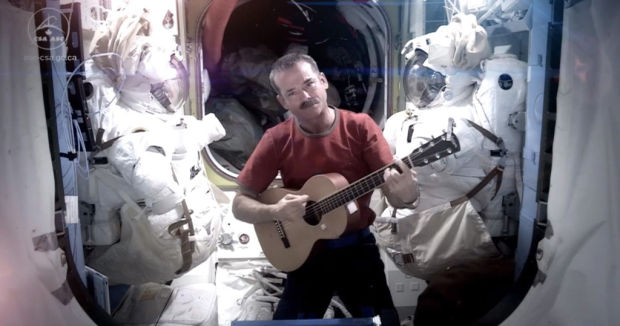 Canadian astronaut covers, posts David Bowie's 'Space Oddity'
