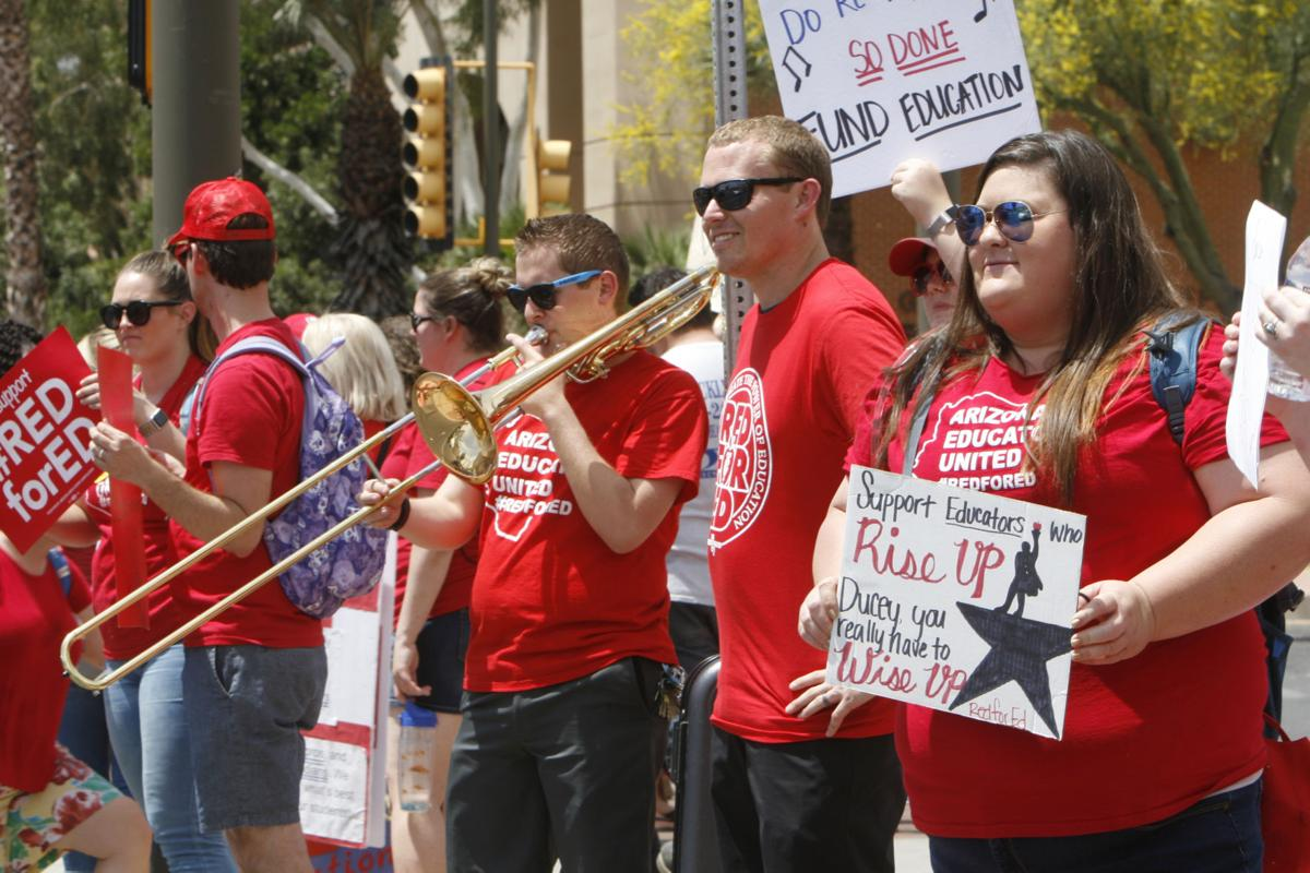 """""""Support educators who rise up. Ducey, you really have to wise up."""""""