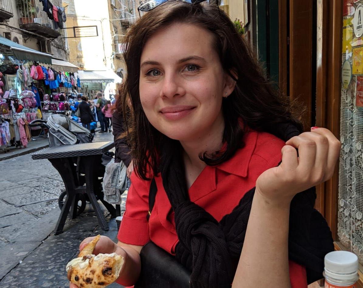 Ellice Lueders eating pizza in Naples