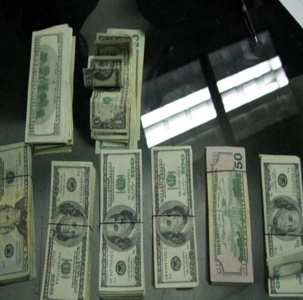 Border agents find $62K under woman's clothes