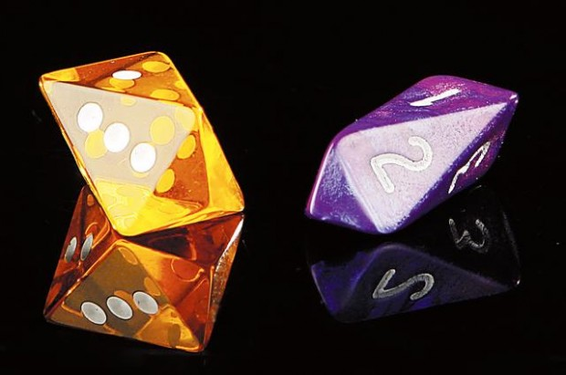 Fancy-dice maker sees patent case roll his way