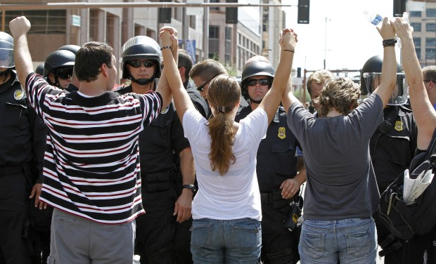 AZ immigration-law protests lead to arrests, street closures