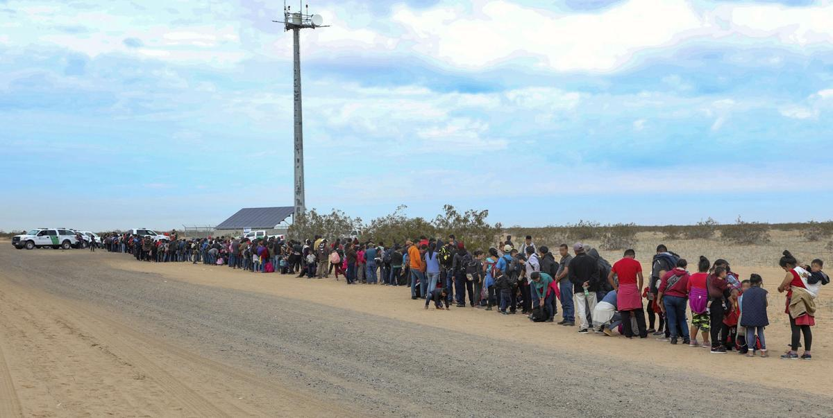 Migrants waiting to be processed