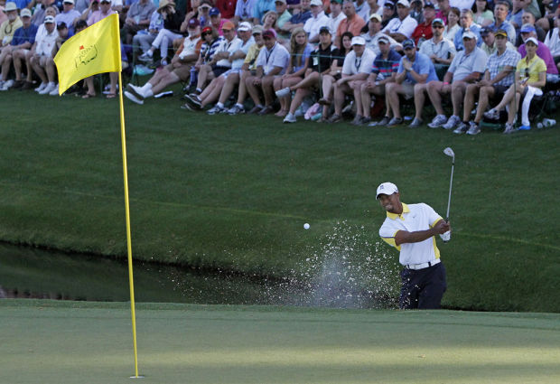 Masters Notebook: Tiger wavers after hitting flagstick, bogeying No. 15
