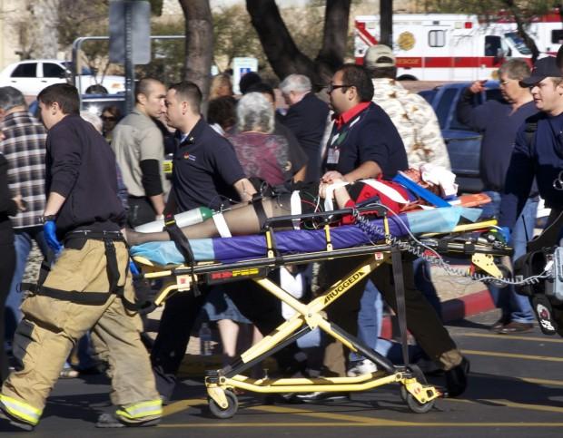 Congresswoman shot, six dead