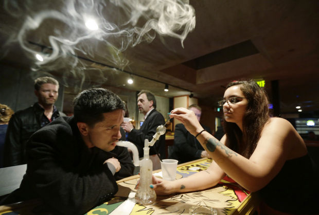 Bars in Washington, Colorado test the limits of their state's law legalizing marijuana