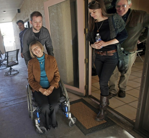 Shot twice, Giffords aide stays upbeat