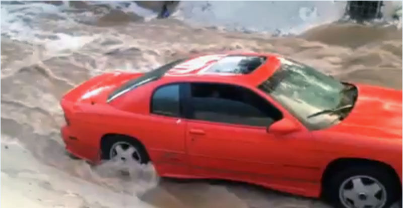2 rescued from wash in early storm today