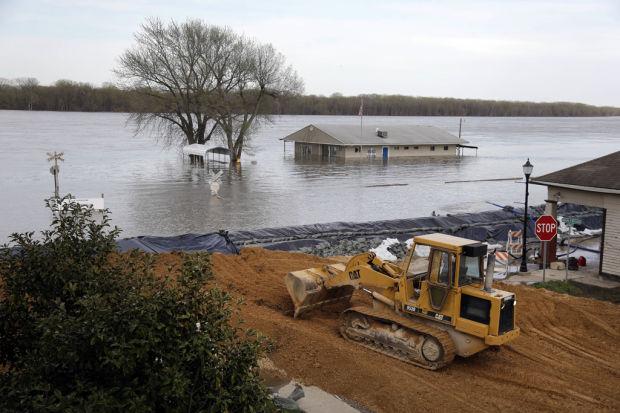 In Missouri tourist town, it's river views versus flood peril