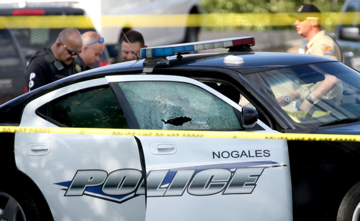 NPD officer shot