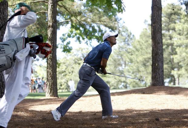 Masters: Tiger avoids DQ, still in hunt