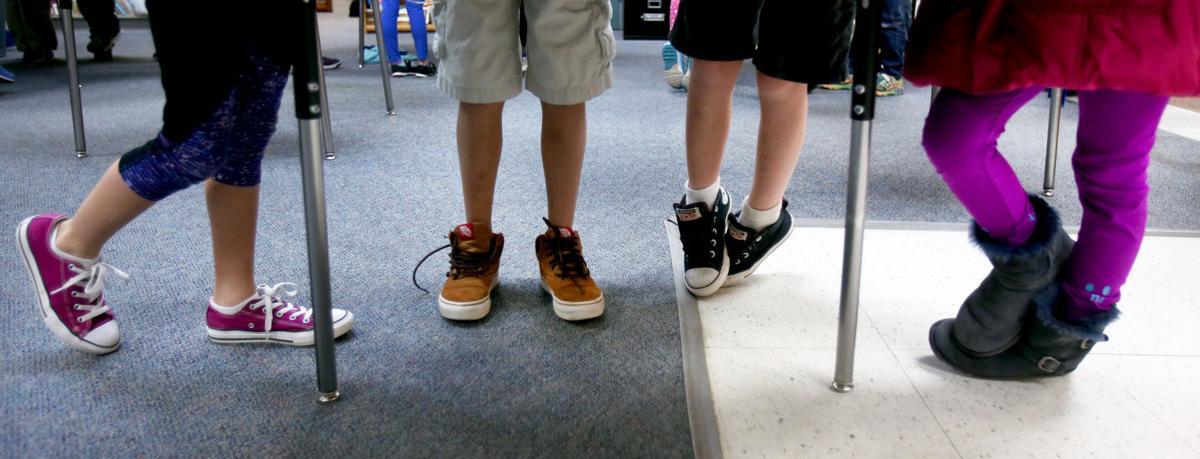 Kids use standing desks