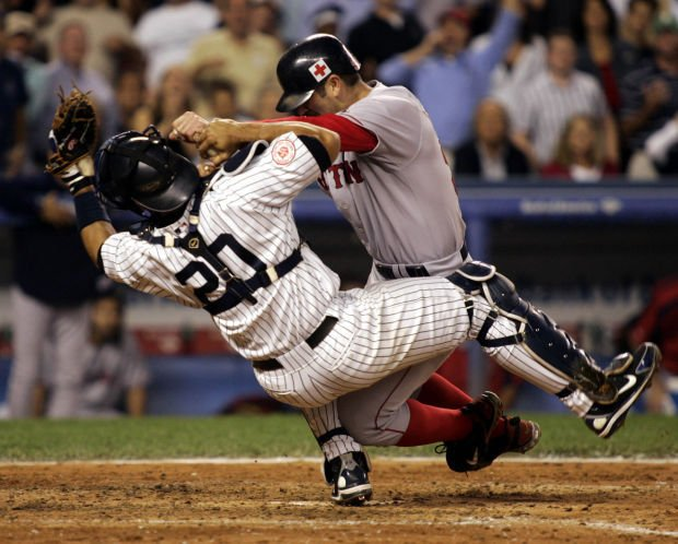 New York Yankees Posada gets out in home plate collision with Boston Red Sox Varitek in New York