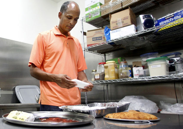 Ethiopian dishes, refugee aid served
