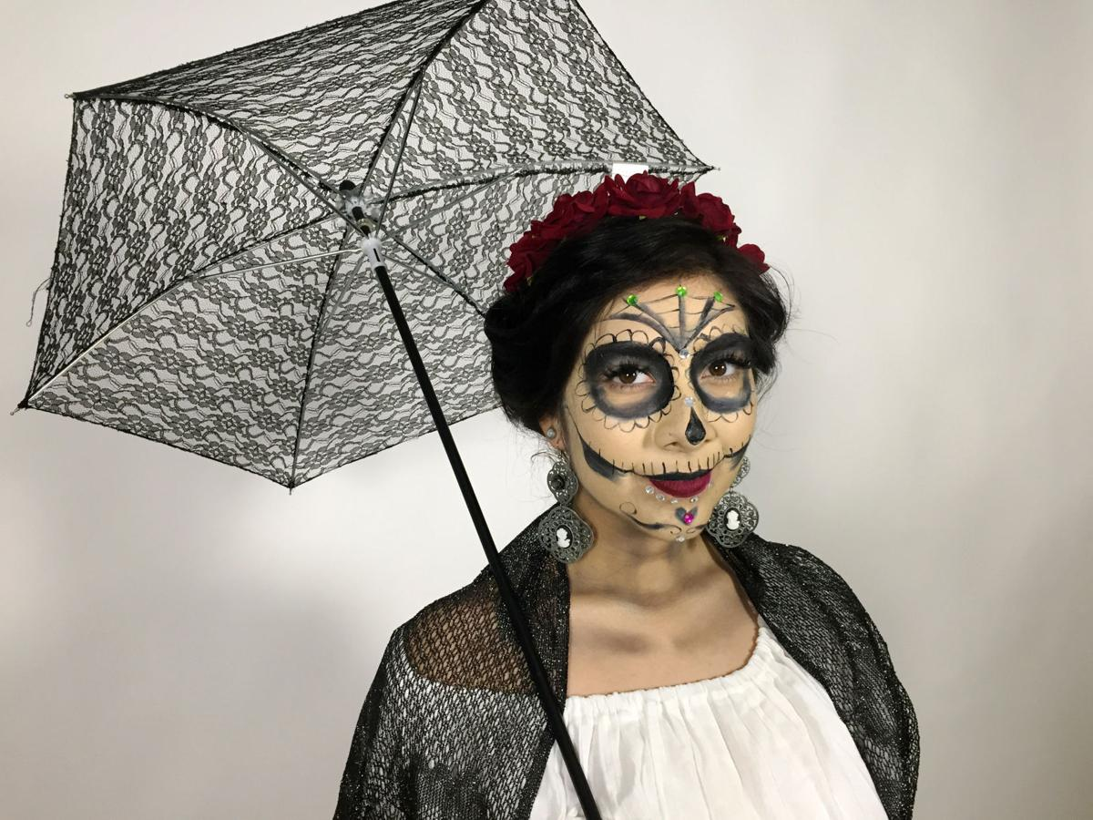 Krystal gets ready for the All Souls Procession