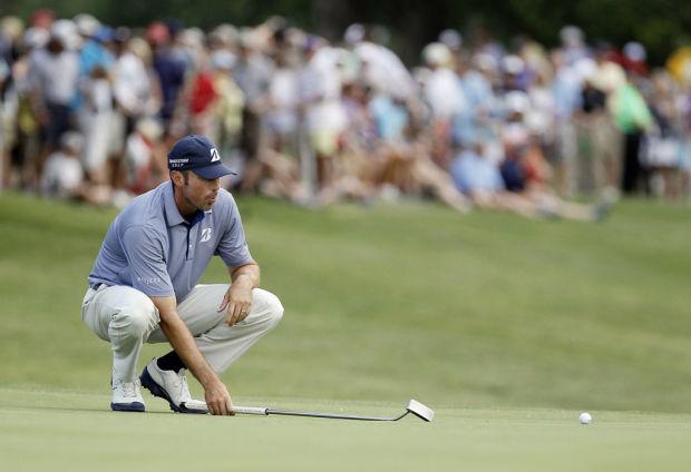 Golf: 69 helps Kuchar keep lead