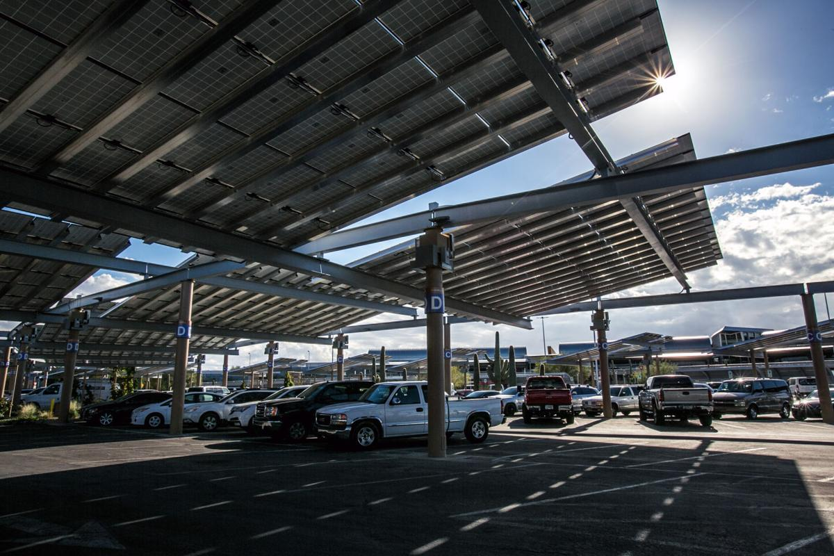 The Sun Ks Out From Corner Of Completed Photovoltaic Array Project Over Hourly And Daily Parking Lots At Tucson International Airport On