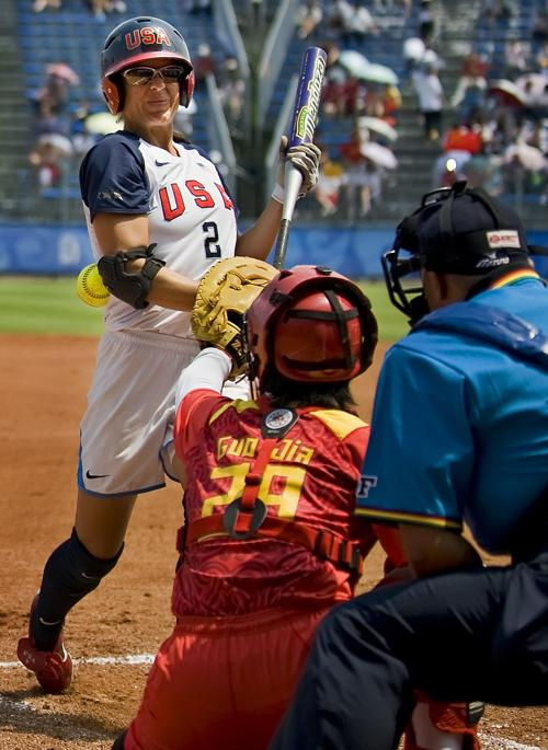 Jessica Mendoza of the United States is hit by a pitch against China on Monday, August 18, 2008, in the games of the XXIX Olympiad in Beijing, China.