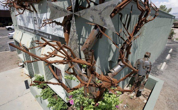 Tucson Oddity: Gnarled metal 'tree' takes firm root at piercing studio