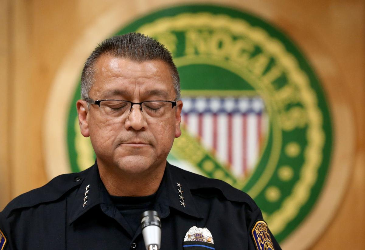 Nogales police officer shot to death by suspected carjacker