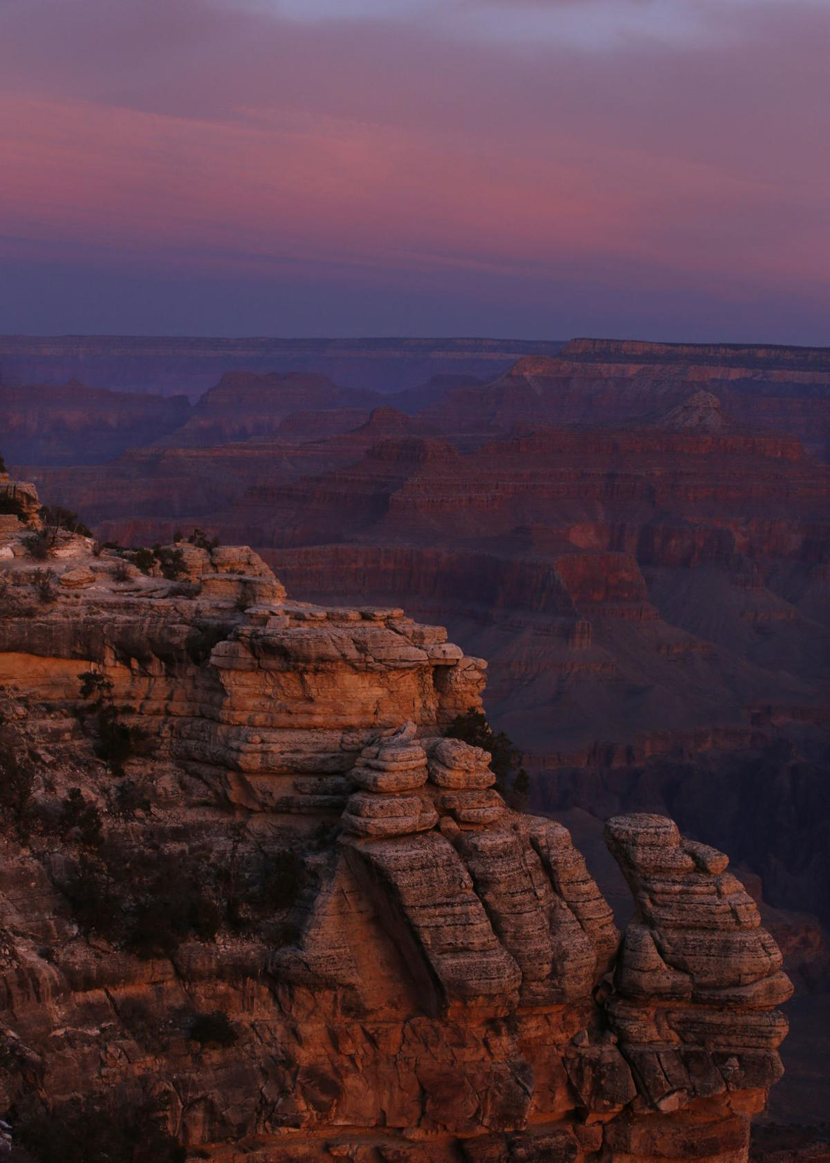 The colors of dawn begin to paint the age-old rock formations of the Grand Canyon along the South Rim near Mather Point on March 11, 2015.