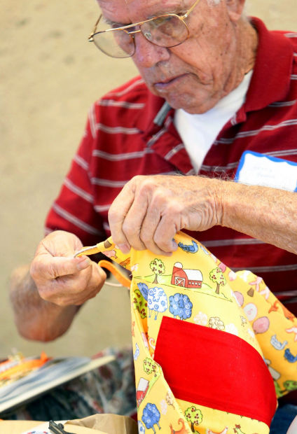 Volunteers make attractive bags for kids told by CPS to pack up