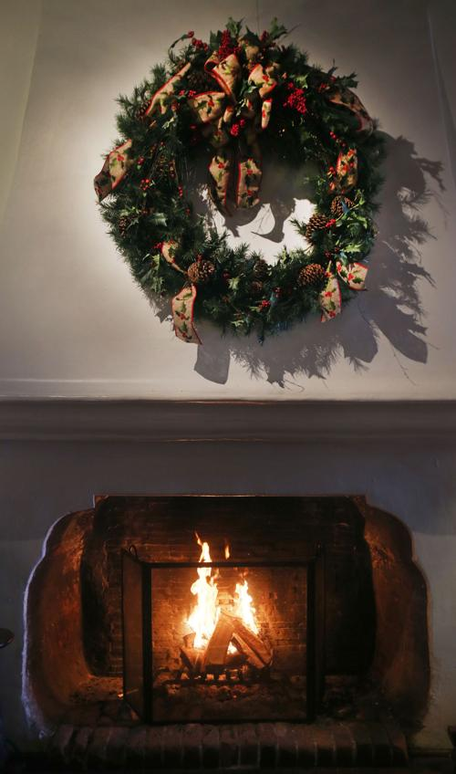 8 tips to protect yourself from fireplace smoke tucson a christmas wreath hangs over a wood fire solutioingenieria Gallery