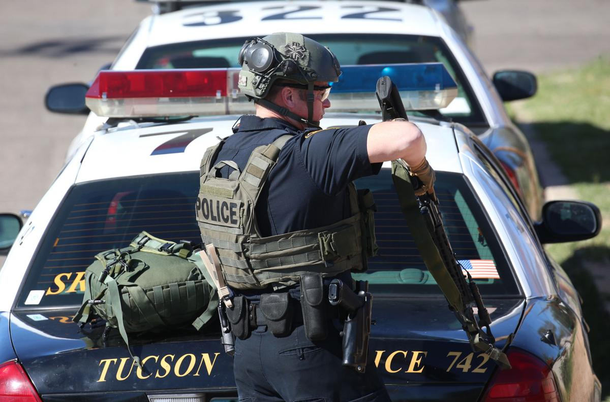 Tucson police standoff ends with woman seriously injured
