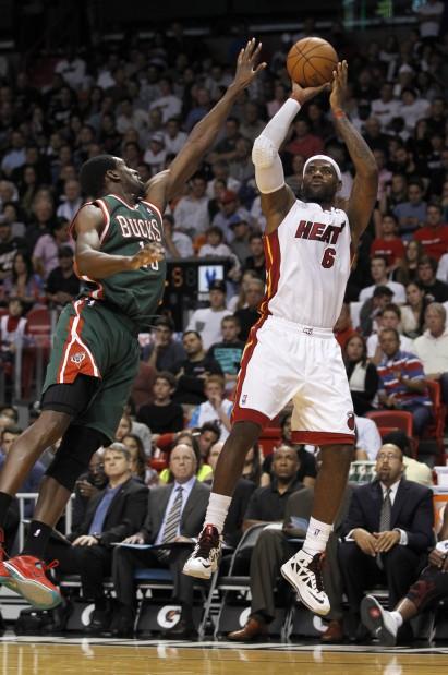 NBA: Heat's Big Three scores 80 in OT victory