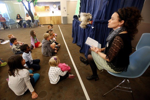 Christmas puppet show reaches out to kids at library
