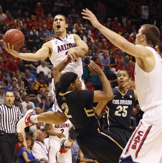 Pac-12 men's basketball tournament: No. 18 Arizona 79, Colorado 69: Buffs out; Bruins next