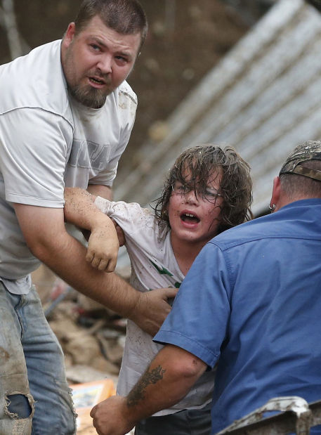 Parents become rescuers at flattened elementary school