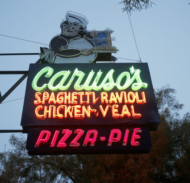 Nostalgic Caruso's restaurant sign in Tucson glows again