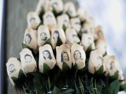 Sandy Hook children's faces on white ros--1d70.jpg