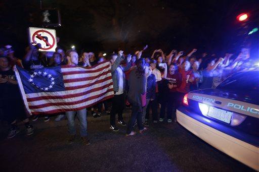 Massachusetts residents celebrate the arrest