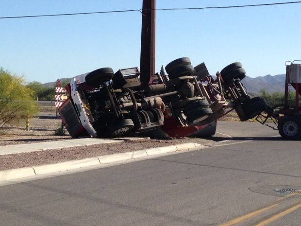 Marana road closed after tractor-trailer overturns