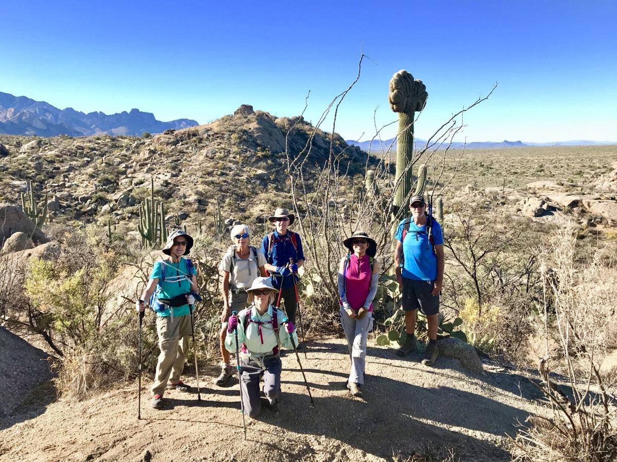 2020-11-19-Hikers-Pose-before-a-Crested-Saguaro.jpg