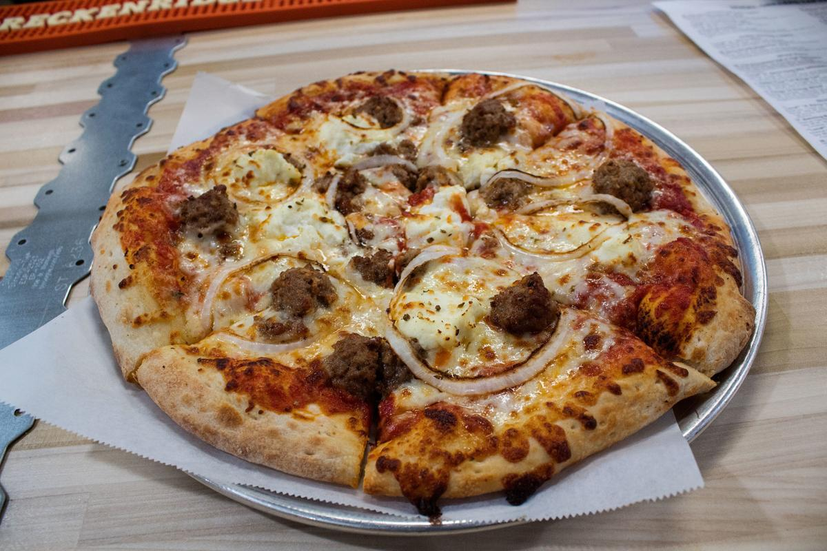 The Small Jigsaw Pizza 15 75 At New Serial Grillers Is One Of More Traditional Pizzas With Meat Ricotta Cheese And Sliced Yellow Onions