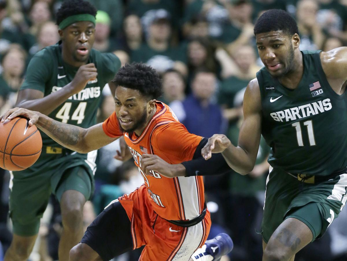 On January 2, 2020, Illinois' Alan Griffin is pursued down court by Michigan State's Gabe Brown (44) and Aaron Henry (11) during the second half at Breslin Center in East Lansing, Mich.