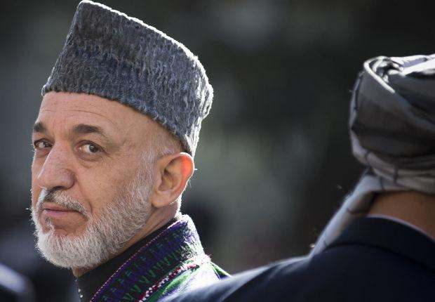 Karzai says he'll curb coalition airstrikes
