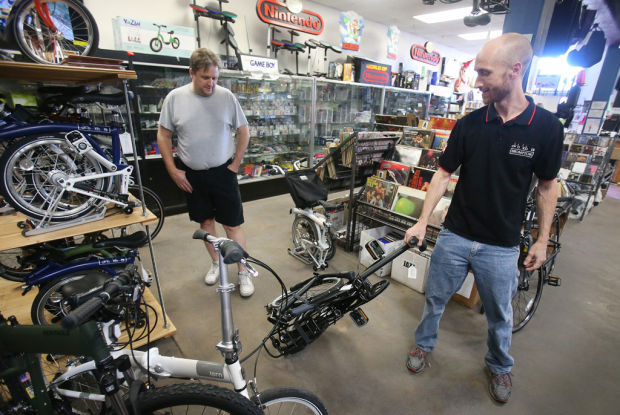 basses to bicycles music store adds folding bikes. Black Bedroom Furniture Sets. Home Design Ideas