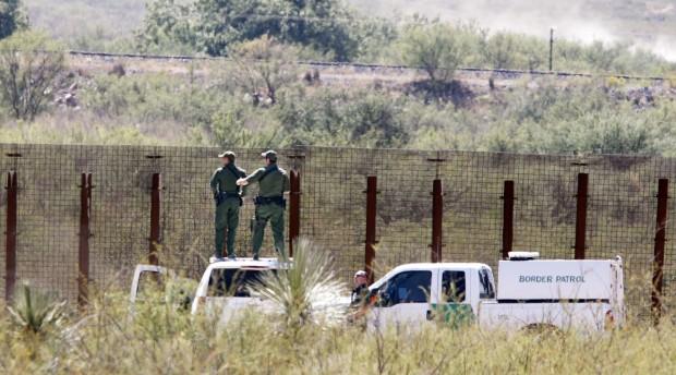 Border agent slain; partner wounded