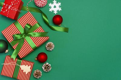 Gift Boxes, Christmas Balls, Toys, Fir Cones, Ribbon On Green Background. Festive, Congratulation, N
