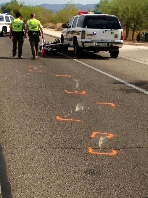 Motorcyclist hits sheriff patrol car