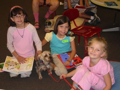 Children read to dogs