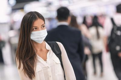 Virus mask Asian woman travel wearing face protection in prevention for coronavirus in China. Lady w
